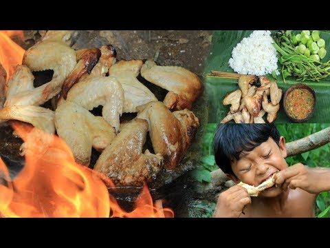 Primitive Technology - Cooking chicken wing on a rock for dinner
