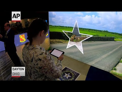 A French-developed tablet called the HistoPad is giving museumgoers in Ohio the opportunity to travel back in time and experience the milestone D-Day World War II invasion 75 years later. (May 13)