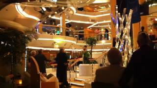 Lady Playing The Violin In Carribean Cruise