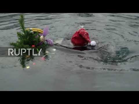 Divers filmed rocking around underwater Christmas tree in Kazan lake