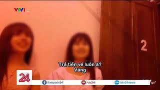 Lừa đảo mại dâm, chiếm đoạt tài sản trên phố Trần Duy Hưng, Hà Nội | VTV24