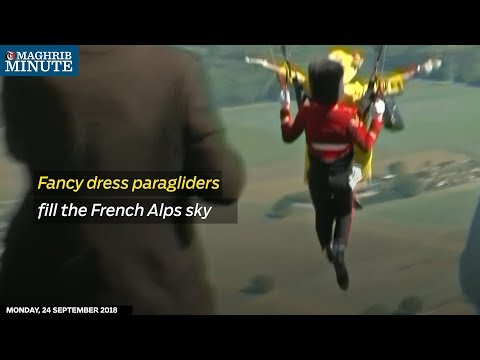 Fancy dress paragliders fill the French Alps sky