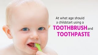 At what age should children start using a toothbrush and toothpaste?
