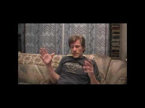 Image of David Kupisiewicz sitting on a couch