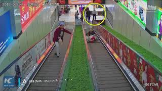 Heroic Moment! Passerby Saves Girl Stuck In Escalator In NW China