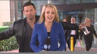 Hugh Jackman photobombs reporter Jessica Turner