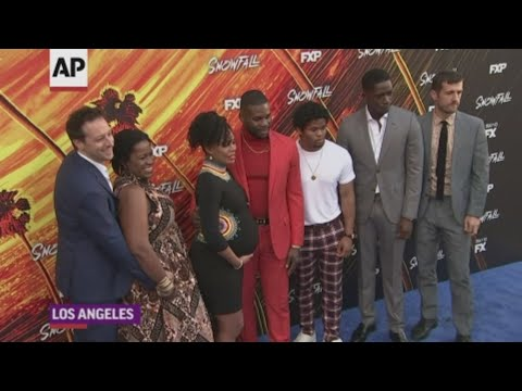 "At the season one premiere of FX show ""Snowfall,"" which the late John Singleton helped produce, the cast discussed his contribution to the series. (July 9)"
