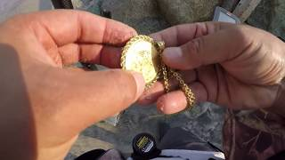 i found MEGA TREASURE  24K GOLD COIN CENTENARY METAL DETECTING