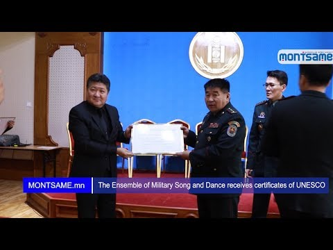 The Ensemble of Military Song and Dance receives certificates of UNESCO