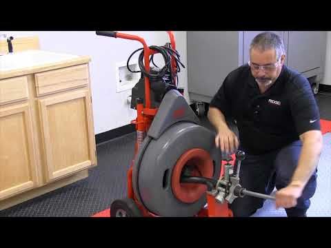 How to remove and reinstall the power feed on the RIDGID K7500 drum machine