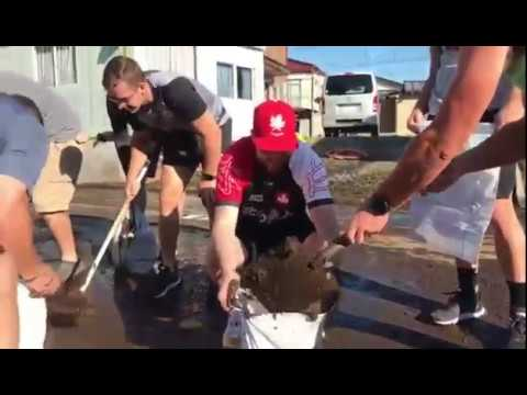 Canadian rugby players volunteering for typhoon relief efforts in Japan after their match with Namibia was cancelled