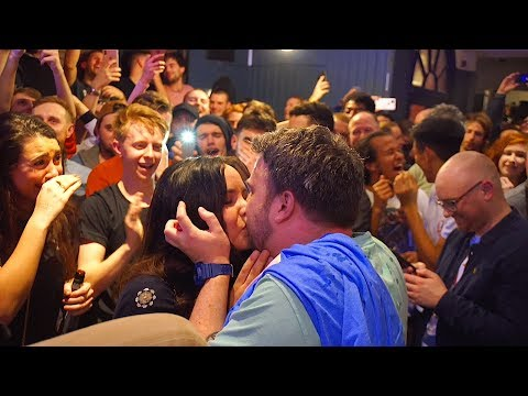 Guy proposes during a Marc Rebillet aka Loop Daddy concert