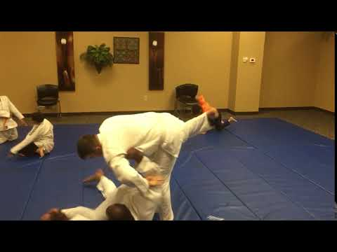Some of my newest students practicing one of the first throws you'll ever learn in judo: the osoto gari.