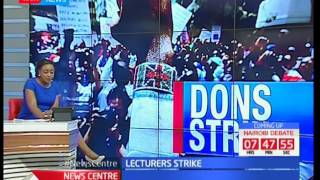 University lecturers down their tools and take to the streets in protest over unpaid dues after CBA