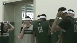 Michigan State players celebrate Cassius Winston's player of the year award