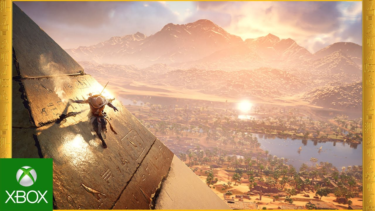 Bayek slides down a pyramid in ancient Egypt