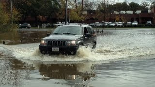 Jeep Driving Through Flooded Streets In Sacramento