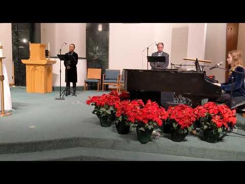 Socially distanced quartet singing O Holy Night, Christmas 2020