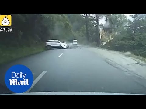 Shocking Moment Car Is Smashed By A Massive BOULDER