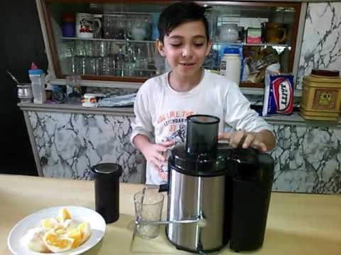 Como hacer jugo exprimido de naranja en la juguera ultracomb