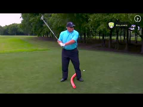 Stay in Balance at Top of the Swing