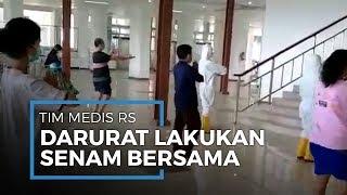 Tim Medis RS Darurat Wisma Atlet Ajak Pasien Virus Corona Senam Bersama