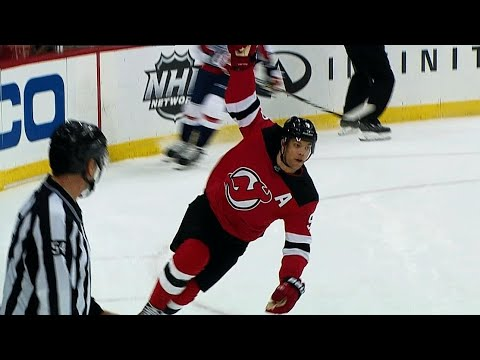 Taylor Hall pokes puck ahead, roofs OT winner past Braden Holtby