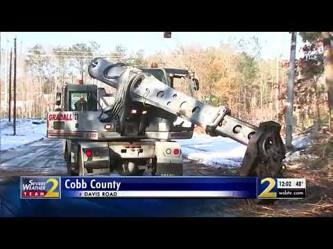 GDOT crews work to restore power, clean debris from snow storm