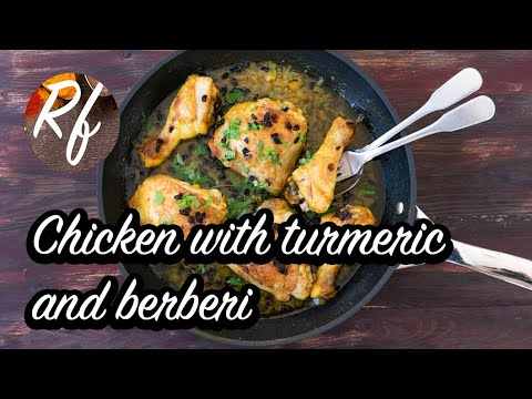 Baked chicken with turmeric, butter, onion and berberi garnished with chopped parsley. >