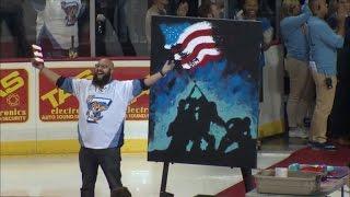 Watch Talented Man Sing National Anthem While Painting Artwork at Same Time