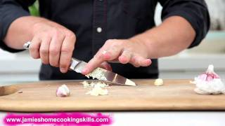 Jamie Oliver talks you through preparing garlic