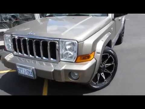 2010 JEEP COMMANDER RIDING ON 20 INCH OFF ROAD RIMS & TIRES