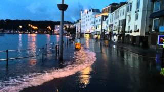 preview picture of video 'High tide tips into the town at St Peter Port'