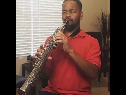 Performing Cole Porter's I love you on soprano saxophone.
