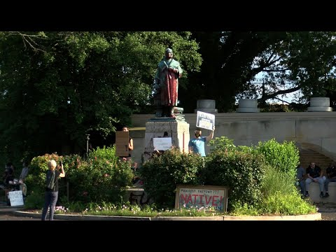 Richmond protesters topple Columbus statue, toss it in lake