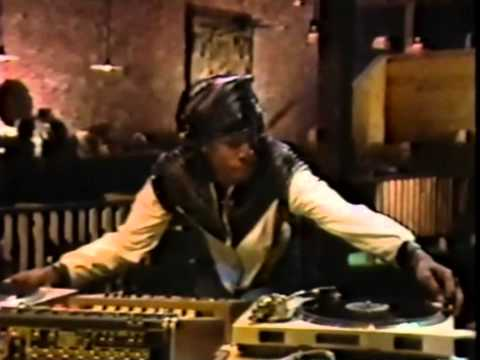 Legendary hip-hop dj pioneer, grandmaster flash shows how to scratch and mix