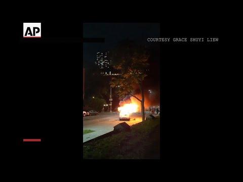 Police van burns in Brooklyn protest