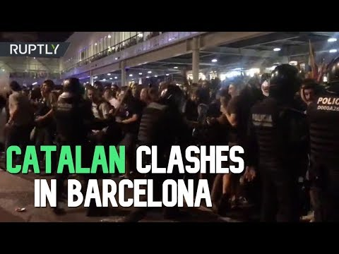 Fierce clashes between Catalan pro-independence protesters and police at Barcelona airport