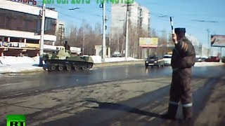 Dash cam video: BMD-2 tank hits streetlight in Russian road accident