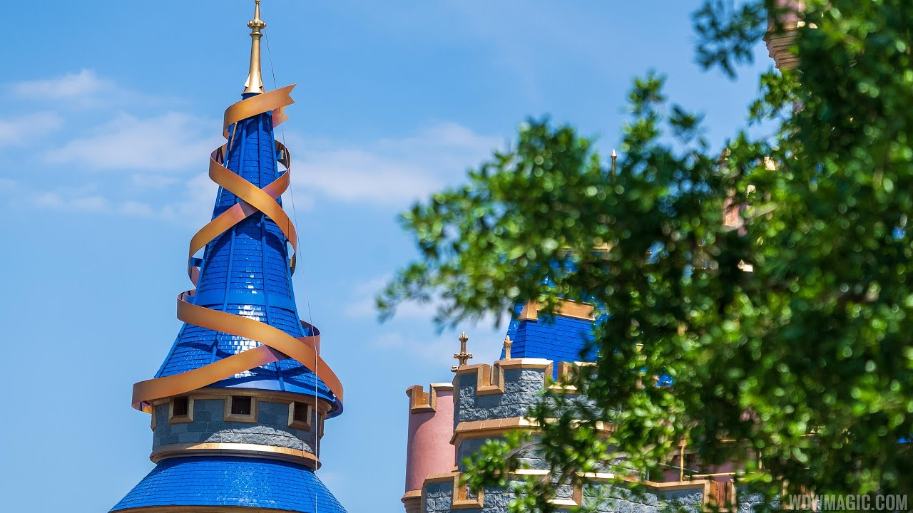 First spire ribbon installed at Cinderella Castle for the 50th