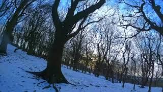 Setting sun an ice cold snowy woodland fpv trip.