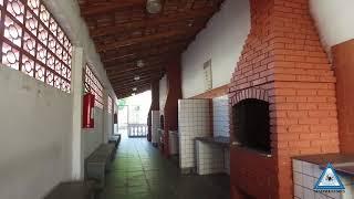 Colônia de Férias de Praia Grande 65 apartamentos, piscina e quadra de jogos.