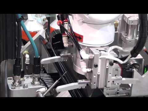Robotic loading a Guidewire on a Royal Master Centerless Grinder