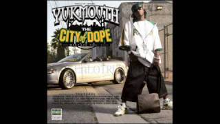 Yukmouth - gangsta , hustla , playa & a pimp it.