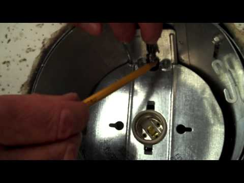 How to remove the socket plate from a recessed housing