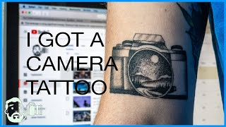 I got a photography tattoo...