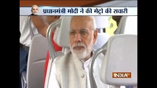 PM Narendra Modi rides in a metro from Dhaula Kuan to Dwarka