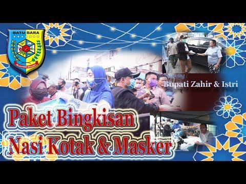 Bupati Batu Bara dan Ketua TP PKK Membagikan Masker dan Nasi Kotak