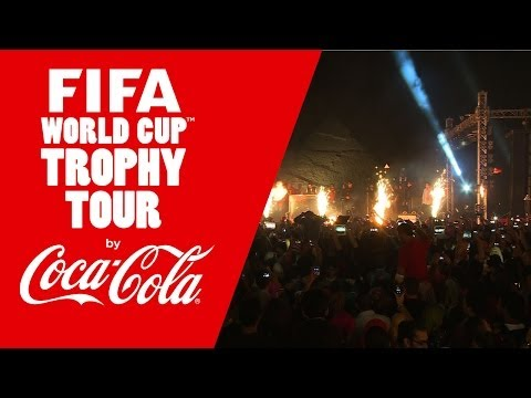 Cairo celebrates with the FIFA World Cup Trophy