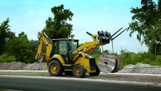 The new Cat® Backhoe Loader at work